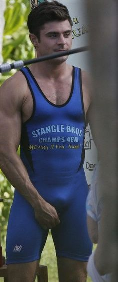 Zac Efron Wears Tight Wrestling Singlet with Adam DeVine!: Photo Zac Efron shows off his buff muscles while wearing a skintight onesie on the set of his upcoming movie Mike and Dave Need Wedding Dates on Tuesday (June in Oahu,… Zac Efron, Anna Kendrick, Oahu, Adam Devine, Wrestling Singlet, Lycra Men, Hommes Sexy, Athletic Men, Athletic Body