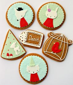 How whimsical are these cookies with fondant & royal icing accents. Love the soft colour palatte!