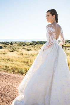 The beautiful Allison Williams in a custom Oscar de la Renta bridal gown by Peter Copping for her September wedding at Brush Creek Ranch in Wyoming. Photo by Christian Oth Studio