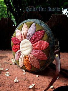 Like the flower.... Make a fan cushion from scraps.