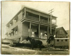 A photograph showing an ambulance outside of the Red Cross Hospital. Hospital staff are standing on the porch. Family Roots, Red Cross, Ambulance, View Image, Small Towns, Cobalt, Porch, Photograph, Adventure
