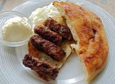 Ćevapi (chevapi) are minced beef and pork or lamp, seasoned and shaped to a size similar to a breakfast sausage