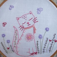 This is a PDF hand embroidery pattern for a cute little kitten sitting in a garden stitched in my favourite pinks and reds. She can either be stitched and then framed in a hoop or stitched and then stuffed with lavender or stuffing and made into a cute little cushion. The kitten measures