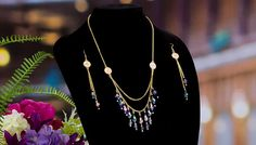 Gold chain necklace and earrings with purple crystals