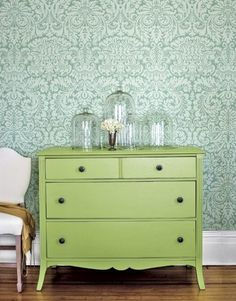 I'm a fan of this wall paper and the lime green color with it.