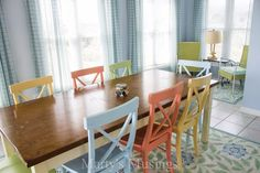 This Dreamy Beach Home Is Filled To The Brim With Color I love the different colored chairs with the stained and painted table! shb