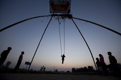 Oct. 23, 2012. Nepalese children play on a bamboo swing at sunrise during the ninth day of the 15-day-long Dashain festival in Kathmandu, Nepal.