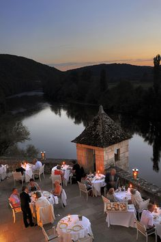 Romantic night at the Château de la Treyne. Hotel and restaurant on a river. France, Lacave.