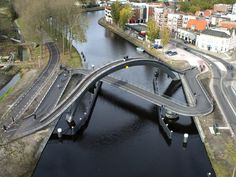 "Article source: NEXT Architects The Melkweg bridge is located in Purmerend, the Netherlands. The bridge is part of the masterplan 'De Kanaalsprong' and connects the historic city center with the towns' new district. ""The aim of the design . Arch Bridge, Pedestrian Bridge, Landscape Architecture, Landscape Design, Architecture Design, Green Architecture, Urban Landscape, Amazing Architecture, Garden Design"
