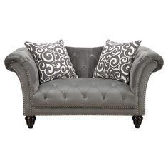 Add stately style to your living room or den with this elegant loveseat, showcasing rolled arms, nailhead trim, and a button-tufted seat.  ...