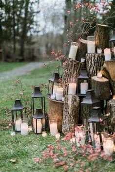 lantern and candle ceremony backdrop - photo by Emily Wren http://ruffledblog.com/woodland-romance-wedding-inspiration