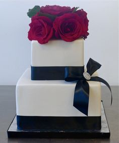 Formal black & white with red roses by The Butter End Cakery. Gorgeous.