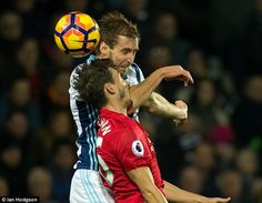 Baggies defenderCraig Dawson (left) goes up for a header with right back Matteo Darmian