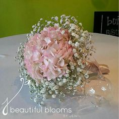 Simple But Beautiful Wedding Bouquet Showcasing: White Baby's Breath (Gypsophila) Surrounding Pink Hydrangea (Hortensia) Hand Tied With Mauve Satin Ribbon