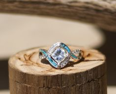 Custom engagement ring with hand set turquoise.
