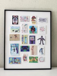 Too much kids art and not enough space? Have the art shrunk and mounted on foam core board before putting in a sleek frame.