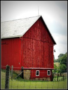 """Rain clouds can't diminish the beauty of this """"bank barn"""" in Fombell, Beaver County, Pennsylvania. The barn has appeared in numerous calendars & magazines."""