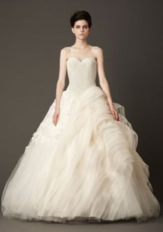 Floating Chantilly lace ball gown with bias organza and tulle wave flange detail. Available in white, shown in ivory.