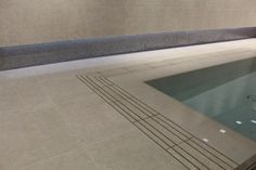 Swimming pool edges made from porcelain tile allowing for a seamless finish. Suitable for overflow and level deck pools