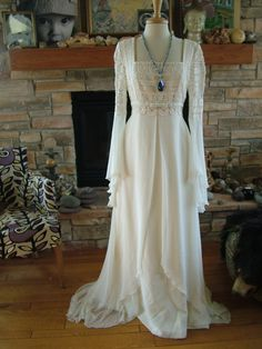 Wedding dress Romeo juliet renaissance style bridal gown poet sleeves celtic lord of the rings bridal. $350,00, via Etsy.