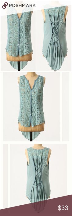 """Anthropologie Chawton Cottage Top by Tiny Sz L EUC Tiny from Anthropologie  Chawton Cottage Top  Made modern with an asymmetric hem, romantic lace & corseted back. Sheer, open knit. Buttondown.  Size L  Cotton & viscose  Excellent used condition!  Bust: 20"""" across the front, lying flat. Has stretch.  Length: 24.25"""" from shoulder to hem.   ✳️ Bundle to Save 20%!  ❌ No Trades, Holds, PP, Modeling   100% Authentic!   ⭐️⭐️ Suggested User • 1500+ Sales • Fast Shipper • Best in Gifts Party Host…"""