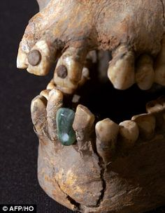 A distinctive feature, showing the woman was a 'foreigner' in Teotihuacan, is the two round pyrite stones encrusted in her top front teeth (shown) a technique used in Mayan regions in southern Mexico and Central America