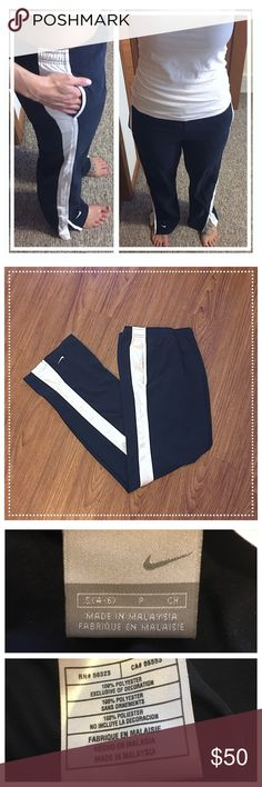 "Nike navy blue/white boot cut pants with pockets 📦Same day shipping (as long as P.O. is open for business). ❤ Measurements are approximate. Descriptions are accurate to the best of my knowledge.  These classic navy blue and white track pants from Nike feature a 4"" slit on the outside of each pant leg so that the pants lay nicely over top of your shoes. 100% polyester. Elastic waist with internal functional drawstring. Flat measurements: 15"" across waist, 10"" rise, 31"" inseam. Excellent…"