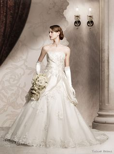 Elegant strapless dress with side ruching, worn with opera gloves.