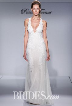 "Brides.com: . ""Style 4436"" ivory, Chantilly lace, fit-and-flare with deep v-neck, low back with romantic appliques and transparent Swarovski crystals, Pnina Tornai for Kleinfeld"