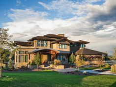 A distinctive domed entry porch adds lots of flair to this Craftsman house plan.  The intricate roof lines and stone accents give you a unique home.  Step up from the entry foyer to a wide hall with double doors that open to the music room.  Beams top the dining room adding a rustic feel.  More beams can be found in the vaulted great room that has a big fireplace at o...