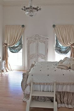Balloon Shades to pull up or down with posh drapes pulled back