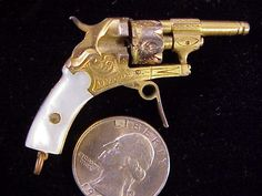 """This is an antique 2mm rimfire double action six shot revolver, probably made in Germany or Belgium in the 1870's. This is a fully functional and shooting miniature revolver and shoots the antique thin rim 2mm rimfire cartridges. 2 1/16"""" long overall with a 27/32"""" barrel."""