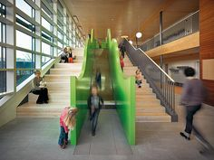 """Hand On"" Modern Childcare Centres - circulation - stairs + slide in atrium."