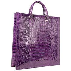 This LAPA large and roomy tote has a timeless and structured shape with a casual-chic touch of Italian croco-embossed calf leather that adds that polished element to your daytime/office look without loosing functionality. Dust bag included Made in Italy Handles: Double Leather handles Handle drop: 3.910cm Hardware: Silvertone metal Lining: Synthetic Leather Pockets: 1 compartment   detachable zip pouch Closure: