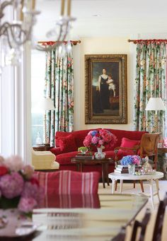 A nineteenth-century Hungarian oil painting hangs above a living room loveseat.