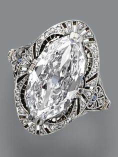 *** Unbeatable savings on wonderful jewelry at http://jewelrydealsnow.com/?a=jewelry_deals *** Diamond ring, circa 1915. The marquise-shaped diamond weighing 3.71 carats, in a pierced frame of conforming shape decorated with small single-cut diamonds and calibré-cut simulated sapphires, mounted in platinum.