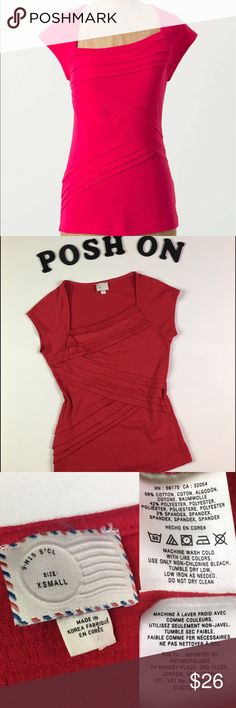 """ANTHROPOLOGIE Postmark Hot Pink Slanted Layers Tee ANTHROPOLOGIE Postmark Hot Pink Slanted Layers Boatneck Tee   Size: XS MSRP: $68 EUC; pet/smoke-free home  Hot pink slanted layers w/crinkled pleats zig zag down this boatneck tee in whittle-your-waist fashion. Asymmetric neckline, short sleeve, figure hugging but very stretchy, super comfy, cotton blend, versatile! EUC; lots of life left in this beauty! Color closest to 1st pic💕  Measures flat approx L:23"""" C:15"""" W:13.5""""  Please ask Qs…"""