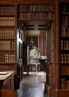 Pencarrow House, Cornwall  Country...   I love the faux wall of books that open to reveal another room.
