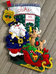 Bucilla Christmas Stocking Felt Appliqué Kit, 86711 Officer Santa: Create an felt stocking featuring Santa as a police officer with the Officer Santa Bucilla stocking kit. Bucilla stockings are gifts that are treasured by those who receive them. Felt Stocking Kit, Christmas Stocking Kits, Felt Christmas Stockings, Santa Stocking, Santa Christmas, Christmas Crafts, Christmas Decorations, Christmas Ornaments, Xmas