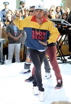 "You know Chris Brown loves to be eccentric! He rocked a colorful Vintage Polo Ralph Lauren Snow Beach Jacket during his performance on the Today Show: His vintage nylon jacket is from the 90′s and features a front ""Snow Beach"" graphic, patches on the left sleeve, and red elbow patches."