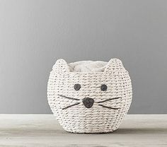 This Kitty Shaped Wicker Basket would make a grr-eat nest for a pussycat like me.