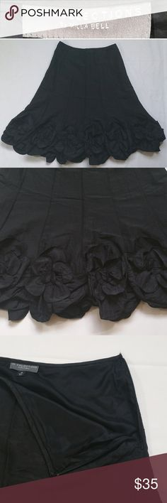 """KM Collection Milla Bell Aline Skirt Floral Hem 14 Condition: Gently used, no major flaws, seam below the zipper is a little loose (see last photo) Size: 14 Pattern/Color: Solid/Black Style: A-line Lined: Yes Material: Self-56% Polyester/44% Nylon.  Lining-100% Acetate  Other Details: Side zipper w/hook & eye closure. Front and back floral hem.  Taffeta or crisp texture. Care: Dry Clean  Approx. measurements (laying flat)  Waist: 16.5"""" Hips: 23"""" Length measured along the side:  30""""  SKU 0494…"""