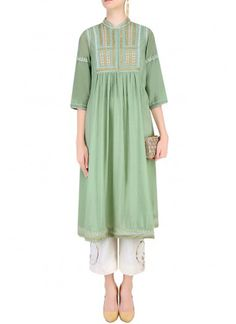Mint embroidered tunic Featuring a mint mandarin collar tunic crafted in silk mul mul with hand beading, sequin scatter and kantha stitch detailing. Indian Fashion Trends, Indian Fashion Designers, Indian Designer Outfits, Designer Dresses, Abaya Fashion, Fashion Dresses, Women's Fashion, Kurta Designs Women, Embroidered Tunic