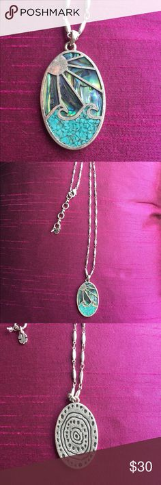 Lucky Brand Beach Ocean Necklace Silver sun waves Lucky Brand authentic BoHo beach necklace on a  long silver chain with mother of pearl sky and turquoise color  inlaid waves. Sunrays and ocean waves and a design on the back too! Excellent condition worn once I just don't wear this enough! Perfect for a festival or pair with the beautiful RipCurl dress I have listed for hot day at the beach! Lucky Brand Jewelry Necklaces