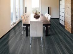 Stunning vinyl floors from COREtec Plus XL Collection in Gotham Oak color. Bring drama to any room with the unique visuals of this vinyl floor.