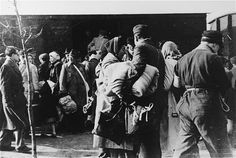 A transport of Jews, either just after their arrival at Westerbork, or just prior to their deportation from the camp.