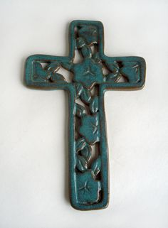 Cross wall hanging with flowers: hand carved green pottery plaque