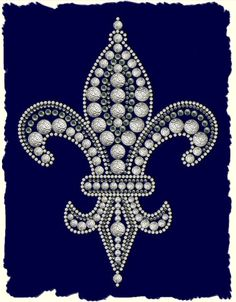 Fleur de Lis  This multi textured design is made up from textured silver studs, cream nailheads and sparkling black crystal rhinestones. The design has an overall size of 140 x 188 mm and is ideal for decorating t-shirts and bags.