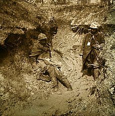 WWI, Verdun 1916; wounded soldiers in the mud. Private Collection C19090