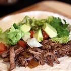 Slow cooker Mexican style beef - can be made with chicken, beef, or pork for burritos, tacos, etc.  top rated (600+ reviews)